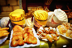 BUENOS AIRES, ARGENTINA: Bakers sell freshly made pastries at a local pastry shop in  Buenos Aires. (Photo by Ami Vitale)