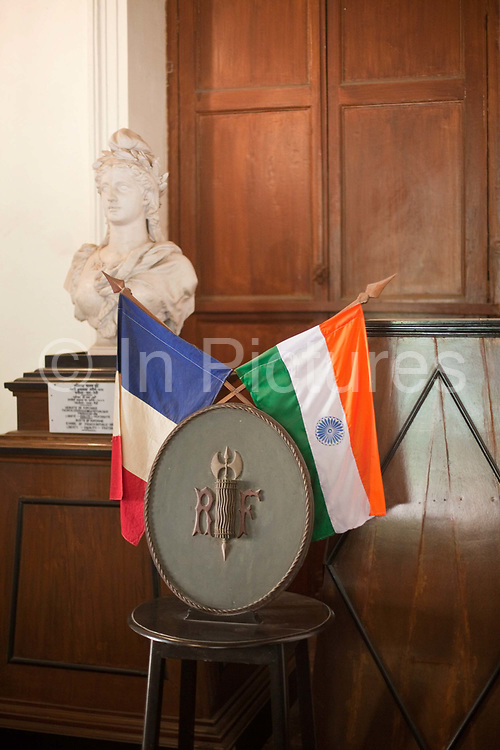 A flag and a bust in the museum at Chandannagar, originally the home of Joseph François Dupleix who was appointed governor of the city in 1730. Chandannagar, India