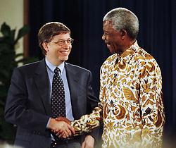 Microsoft CEO BILL GATES, left, with NELSON MANDELA Dec. 9, 1999 in Seattle. (Credit Image: © Barry Sweet/ZUMApress.com)