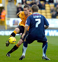 Photo: Ed Godden.<br />Wolverhampton Wanderers v Southend United. Coca Cola Championship. 04/11/2006. Rob Edwards (L) is challenged by Southend's Mark Gower.