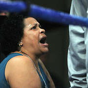 """Dominga Torres-Rivera, mother of fighter Orlando Cruz, yells instructions to her son during his fight against Jorge Pazos at the Kissimmee Civic Center in Kissimmee, Florida, on Friday, October 19, 2012. The Puerto Rican Cruz recently described himself as """"a proud gay man"""" and the first active boxer having pronounced so, in boxing history. Cruz won the fight in a 12-round decision. (AP Photo/Alex Menendez)"""