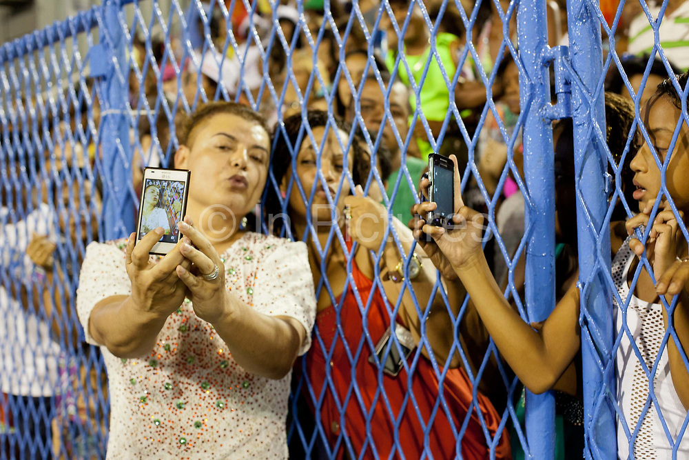 David Brazil posing for photos and talking to the fans before their final practice performance, Grande Rio Samba School from the Special Group, practices their Carnival procession in the Sambadrome, Rio de Janeiro, Brazil