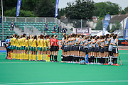 Argentina and South Africa line up for the national anthems ahead of their match in the Investec Hockey World League Semi Final 2013, the Quintin Hogg Memorial Sports Ground, University of Westminster, London, UK on 27 June 2013. Photo: Simon Parker