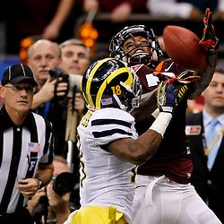 January 3, 2012; New Orleans, LA, USA; Michigan Wolverines defensive back Blake Countess (18) breaks up a pass in the endzone intended for Virginia Tech Hokies wide receiver Marcus Davis (7) during the fourth quarter of the Sugar Bowl at the Mercedes-Benz Superdome. Michigan defeated Virginia 23-20 in overtime. Mandatory Credit: Derick E. Hingle-US PRESSWIRE