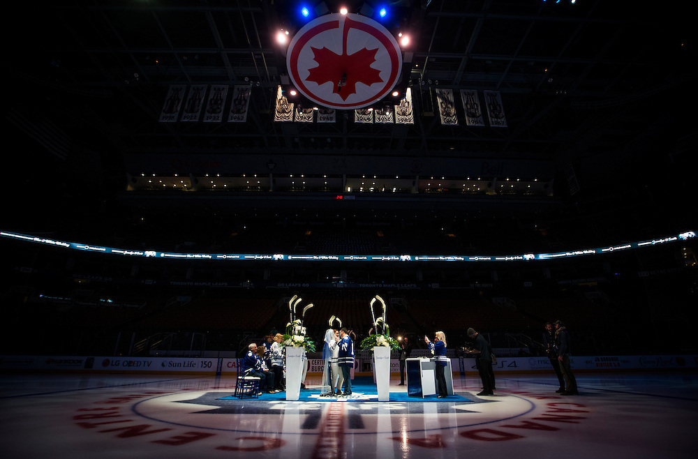 Toronto, Ontario - March 19, 2015 -- TORONTO MAPLE LEAFS WEDDING--  Jennifer Rogers and Scott Protomanni share their first dance at centre ice following their wedding ceremony at the Air Canada Centre where the Toronto Maple Leafs play in Toronto, Thursday March 19, 2015.   (Mark Blinch for the Globe and Mail)