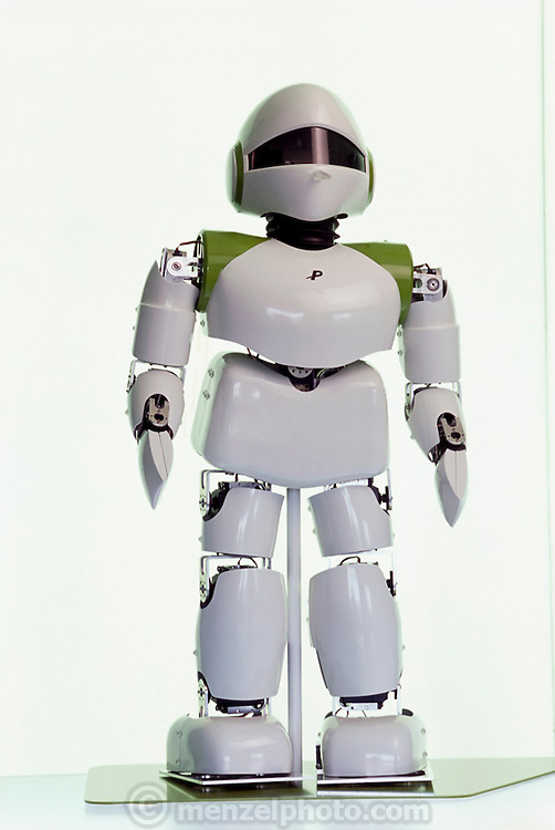 "Pino, short for Pinocchio (after the fabled wooden puppet that becomes a human boy), is a full-bodied, child-sized, humanoid robot. Even before it demonstrates the ability of a wide range of bipedal movements it already has a national following in Japan after the release of a music video called ""Can You Keep a Secret"" in which the robot stars alongside one of Japan's most popular recording artists, Hikaru Utada. It has elevated Tatsuya Matsui, the artist who created the robot design, to celebrity status. The robot project is part of a large ERATO grant from the Japan Science and Technology Corporation, a branch of the Science and Technology Agency of the Japanese government. Project creator Hiraoki Kitano believes that the aesthetics of a robot are important in order for it to be accepted by humans into their living space. At the Kitano Symbiotic Systems, Tokyo, Japan."