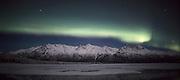 USA, Alaska, Knik River, Aurora borealis over Chugach Mountains