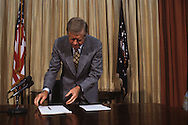 President Jimmy Carter looks over a bill that he is about to sign in the Oval Office in May 1979<br /> <br /> Photograph by Dennis Brack<br /> bb45
