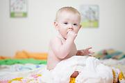 Baby Girl, sitting - looking towards camera.