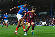 Ellis Harrison (22) of Portsmouth shoots at goal during the EFL Sky Bet League 1 match between Portsmouth and Ipswich Town at Fratton Park, Portsmouth, England on 21 December 2019.