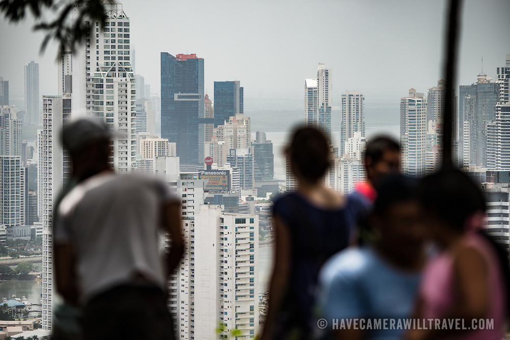 Tourists look out over the highrises of the new area of Panama City from the top of Ancon Hill. Ancon Hill is only 654-feet high but commands an impressive view out over the new and old sections of Panama City. With views out over both the Pacific Ocean and the entrance to the Panama Canal, the area was historically where the administration of the Panama Canal was centered and now has a mix of high-end residences and government departments.