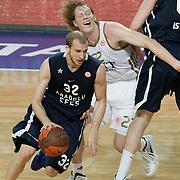 Anadolu Efes's Sinan Guler (L) during their Turkish Airlines Euroleague Basketball Group C Game 10 match Anadolu Efes between Real Madrid at Sinan Erdem Arena in Istanbul, Turkey, Thursday, December 22, 2011. Photo by TURKPIX