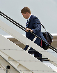 © London News Pictures. 06/06/2012. Luton, UK.  England and Liverpool captain Steven Gerrard boarding a plane at Luton Airport in Bedfordshire on June 6, 2012 to head to Poland for the Euro 2012 football tournament. The squads training camp is based in Krakow.  Photo credit: Ben Cawthra/LNP