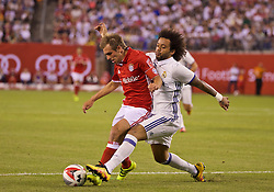 NEW JERSEY, USA - Wednesday, August 3, 2016: Real Madrid's Marcelo Vieira Da Silva in action against Bayern München's captain Philipp Lahm during the International Champions Cup match at the Red Bull Arena. (Pic by David Rawcliffe/Propaganda)