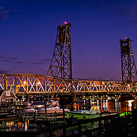 The Memorial Bridge in Portsmouth, NH at night.<br /> <br /> All Content is Copyright of Kathie Fife Photography. Downloading, copying and using images without permission is a violation of Copyright.