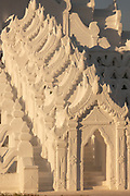 Detail of the white Hsibyume Pagoda, Myanmar. Many believe that it represents Mount Meru, which according to Hindu and Buddhist mythology is the center of the universe. It was built by the crown prince in memory of his first wife