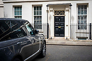 A rare ray of sunshine hits the main front door of number 11 Downing Street, the home of the chancellor of the exchequer on the 25th of May 2021 in Westminster, London. UK.