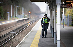 CAPTION CORRECTION © Licensed to London News Pictures. 05/01/2019. Horsley, UK. A British Transport police officer patrols at Horsley station in Surrey where a man was stabbed to death on a train yesterday. A murder investigation has been launched after the man was attacked while on board the 12. 58pm train service travelling between Guildford and London Waterloo. A man and a woman have been detained by police in Farnham in connection with the murder. Photo credit: Peter Macdiarmid/LNP