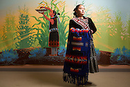 """CLIENT: SMITHSONIAN MAGAZINE<br /> <br /> Crystal Littleben, 23, from the Navajo Nation's Central Agency, one of five contestants for the title of Miss Navajo 2015-2016, at the Navajo Nation Museum in Window Rock, Arizona. For her Miss Navajo """"traditional skill,"""" Crystal demonstrated the uses of different types of corn."""
