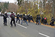 Nov. 11, 2015 - Wegscheid, Bavaria, Germany - GERMANY, Bavaria, Wegscheid; <br /> <br /> Changing tactics, as pro-refugee supporters run from police cordons along their route and take to the hills and farmland.  Left wing rally in support of a pro-refugee, no borders policy as it makes its way from Spielfeld railway station up into the surrounding vineyards and mountain villages to encounter an opposing Right wing rally. The group is a loose co-ordination of Antifas and a local district anti-fascist group, comprised mainly of students and many others.  This alpine region lies on the border of the Slovenian town of Sentilj where a vast refugee processing centre has led to raised tensions around the issue. <br /> ©Exclusivepix Media