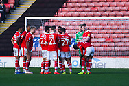 Barnsley players huddle together during the long stoppage for Luke Bolton of Wycombe Wanderers (17) nasty injury during the EFL Sky Bet League 1 match between Barnsley and Wycombe Wanderers at Oakwell, Barnsley, England on 16 February 2019.