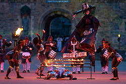 Edinburgh, Scotland, UK. 5 August, 2019.  The Royal Edinburgh Military Tattoo forms part of the Edinburgh International festival. Pictured;  The Trinidad and Tobago Defence force Steel Orchestra perform a limbo under fire