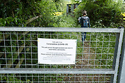 Covid-19 warning sign to people walking on public footpaths to respect social distancing in the countryside in Martley, United Kingdom. Martley is a village and civil parish in the Malvern Hills district of the English county of Worcestershire. Coronavirus or Covid-19 is a new respiratory illness that has not previously been seen in humans. While much or Europe has been placed into lockdown, the UK government has put in place more stringent rules as part of their long term strategy, and in particular social distancing.