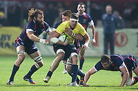 Todd Clever (L) of USA tries to stop Mihai Macovei (C) of Romania during their  rugby test match between Romania and USA, on National Stadium Arc de Triomphe in Bucharest, November 8, 2014.  Romania lose the match against USA, final score 17-27.