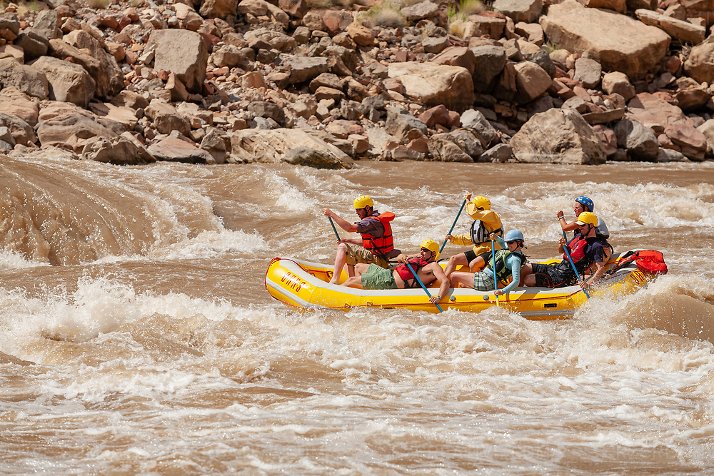 Raft on a rapid in Cataract Canyon — a 46 mile long canyon of the Colorado River located within Canyonlands National Park and Glen Canyon National Recreation Area in southern Utah. Photo © Robert Zaleski / rzcreative.com<br /> —<br /> To license this image for editorial or commercial use, please contact Robert@rzcreative.com