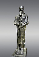 Ancient Egyptian statue of the god Ptah, granodiorite, New Kingdom, 18th Dynasty, (1390-1353 BC)Karnak. Egyptian Museum, Turin. Grey background.<br /> <br /> The statue of the god Ptah is in the likeness of the reigning king Amenhotep III with a youthful almost feminine face, full cheeks, large smiling mouth and fleshy lips. The large almond shaped eyes are characteristic of the period as is the outline of the lips, Drovetti collection. Cat 86 .<br /> <br /> If you prefer to buy from our ALAMY PHOTO LIBRARY  Collection visit : https://www.alamy.com/portfolio/paul-williams-funkystock/ancient-egyptian-art-artefacts.html  . Type -   Turin   - into the LOWER SEARCH WITHIN GALLERY box. Refine search by adding background colour, subject etc<br /> <br /> Visit our ANCIENT WORLD PHOTO COLLECTIONS for more photos to download or buy as wall art prints https://funkystock.photoshelter.com/gallery-collection/Ancient-World-Art-Antiquities-Historic-Sites-Pictures-Images-of/C00006u26yqSkDOM
