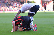 Tottenham Hotspur defender Danny Rose apologises to AFC Bournemouth's midfielder Matt Ritchie during the Barclays Premier League match between Bournemouth and Tottenham Hotspur at the Goldsands Stadium, Bournemouth, England on 25 October 2015. Photo by Mark Davies.