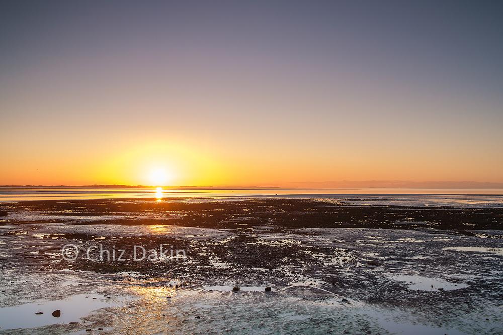 Golden light at sunset over the mudflats of Cockerham Sands