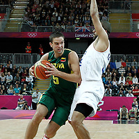 02 August 2012: Lithuania Mantas Kalnietis drives past France Tony Parker during 82-74 Team France victory over Team Lithuania, during the men's basketball preliminary, at the Basketball Arena, in London, Great Britain.