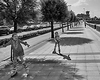 Sidewalk Skaters in Getxo Spain. Image taken with a Leica X2 camera (ISO 100, 24 mm, f/6.3, 1/640 sec). Raw image processed with Capture One Pro, and Photoshop CC 2014