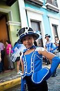 A young majorette parades at the Festival of San Sebastian in San Juan, Puerto Rico.