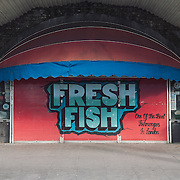 Fishmongers.<br /> 11 Atlantic Road.<br /> <br /> The grandfather of Lorne Mash opened this shop in 1932. He is the third generation and if they will be evicted 2 persons will lose their jobs.