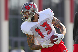 July 28, 2018 - Tampa, FL, U.S. - TAMPA, FL - JULY 28: Mike Evans (13) makes a catch and then turns to run up the field during the Tampa Bay Buccaneers Training Camp on July 28, 2018 at One Buccaneer Place in Tampa, Florida. (Photo by Cliff Welch/Icon Sportswire) (Credit Image: © Cliff Welch/Icon SMI via ZUMA Press)