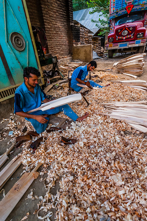 Carving cricket bats by hand at Astro Bat Factory, Kashmir, Jammu and Kashmir State; India.