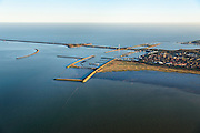 Nederland, Noord-Holland, Den Oever, 11-12-2013; Afsluitdijk met Stevinsluizen gezien vanuit Waddenzee. Haven Den Oever. <br /> Enclosure Dam with Stevin Locks seen from Waddenzee. Port of Den Oever.<br /> luchtfoto (toeslag op standaard tarieven);<br /> aerial photo (additional fee required);<br /> copyright foto/photo Siebe Swart.