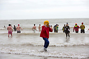 Lego man. Participants dressed up for Folkestone Lions Club Boxing Day Dip.  An annual fancy dress fundraising event, where all sorts of amusing costumes and characters enter the cold sea of the English Channel at Sunny Sands, Folkestone. UK.