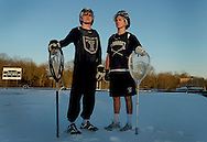 Cohasset High School lacrosse goalies Conor Naughton (cq), senior, left, and Mason Fitzgerald (cq), freshman, right, pose for a portrait outside the school on April 5 in Cohasset, Mass.