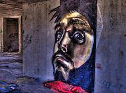 Graffiti of a man on crude concrete