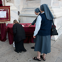 MILAN, ITALY - JUNE 14: A woman and two nuns sign the book of codolence before attending the funeral of Monsignor Luigi Padovese at the Duomo on June 14, 2010 in Milan, Italy. Monsignor Luigi Padovese Bishop in Anatolia was murdered by his own driver on June 3rd in Iskenderun, Turkey ***Agreed Fee's Apply To All Image Use***<br /> Marco Secchi /Xianpix<br />  tel +44 (0) 207 1939846<br />  e-mail ms@msecchi.com <br /> www.marcosecchi.com