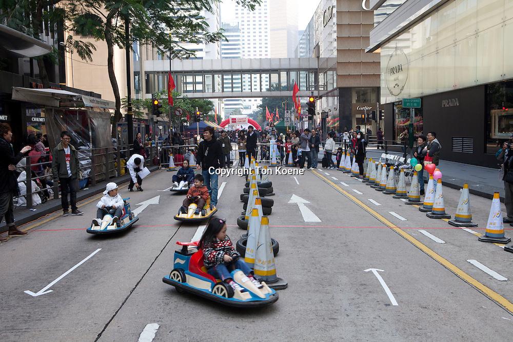 children at fair in hongkong