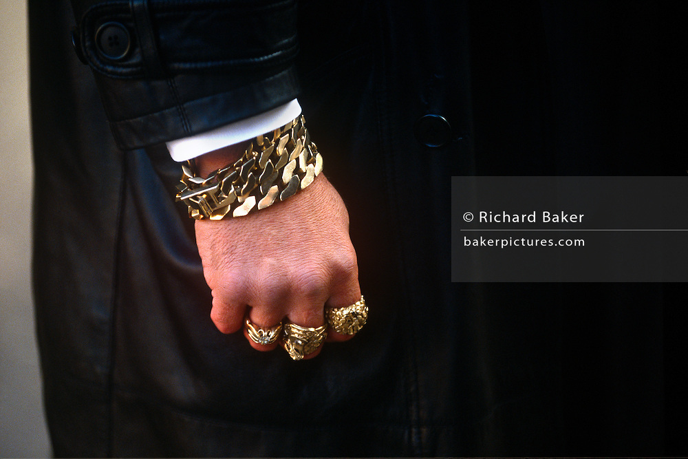 Gold rings and bling of family security man during East End  funeral to notorious 60s gangster twin Ronnie Kray.