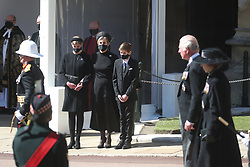 (Left to right) Lady Louise Windsor, the Countess of Wessex and James, Viscount Severn watching the procession, as the Prince of Wales and Princess Anne walk past, at the Galilee Porch of St George's Chapel, Windsor Castle, Berkshire, during the funeral of the Duke of Edinburgh. Picture date: Saturday April 17, 2021.