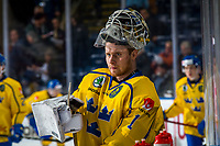 KELOWNA, BC - DECEMBER 18: Adam Åhman # 1 of Team Sweden stands at the bench during warm up against the Team Russia at Prospera Place on December 18, 2018 in Kelowna, Canada. (Photo by Marissa Baecker/Getty Images)***Local Caption***