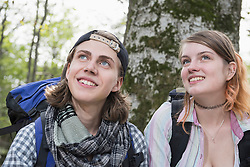 Close-up of a young couple hiker dreaming in a forest, Bavaria, Germany