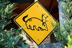 Wombat With Antlers and Tail Road Sign
