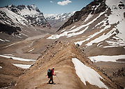 Trekking in remote Pamir mountains - over a high pass at 5100m, the Vrang Pass.<br /> <br /> Trekking over 3 high passes from the end of the Shokhdara valley (at a place called Jawshangoz) to Vrang village, in the Wakhan corridor. Near Khorog town.<br /> <br /> The town of Khorog (2200m), is the capital of the Gorno-Badakhshan Autonomous Province (GBAO) in Tajikistan. It is situated in the Pamir Mountains (ancient Mount Imeon) at the confluence of the Gunt and Panj rivers.<br /> The city is bounded to the south and to the north by the deltas of the Shakhdara and Gunt rivers, respectively. The two rivers merge in the eastern part of the city flow through the city, dividing it almost evenly until its delta in the river Panj, also being known as Amu Darya, or in antiquity the Oxus on the border with Afghanistan. Khorog is known for its beautiful poplar trees that dominate the flora of the city.<br /> Khorog is one of the poorest areas of Tajikistan, with the charitable organization Aga Khan Foundation providing almost the only source of cash income. Most of its inhabitants are Ismaili Muslims.<br /> <br /> Tajikistan, a mountainous landlocked country in Central Asia. Afghanistan borders it to the south, Uzbekistan to the west, Kyrgyzstan to the north, and People's Republic of China to the east. Tajikistan also lies adjacent to Pakistan separated by the narrow Wakhan Corridor.<br /> Tajikistan became a republic of the Soviet Union in the 20th century, known as the Tajik Soviet Socialist Republic.<br /> It was the first of the Central Asian republic to gain independence in December 1991.